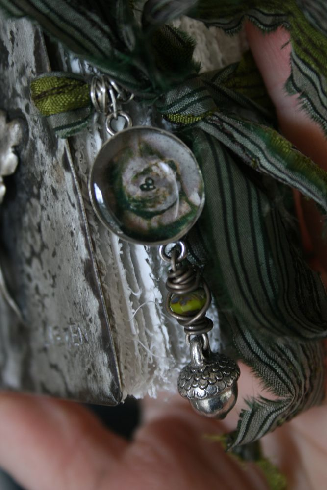 Green book charm detail