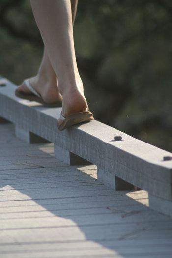 Feet on rail