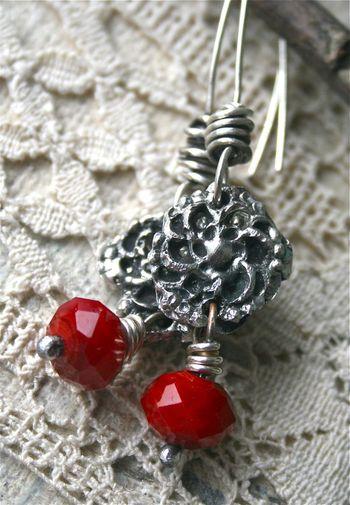 Cast earrings, red